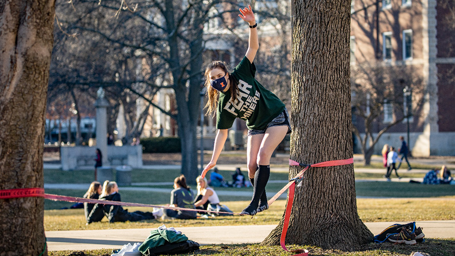 Spring weather beckons students to try out their slack line skills on the main quad as students study, play and socialize outdoors during a year of COVID-19 safety precautions. Photo by Fred