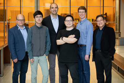 Group portrait of researchers Wawrzyniec Dobrucki, Zhongmin Zhu, Viktor Gruev, Zuodong Liang, Steven Blair and Shuming Nie.