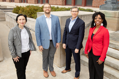A group photo of Illinois researchers, standing outdoors and socially distanced.