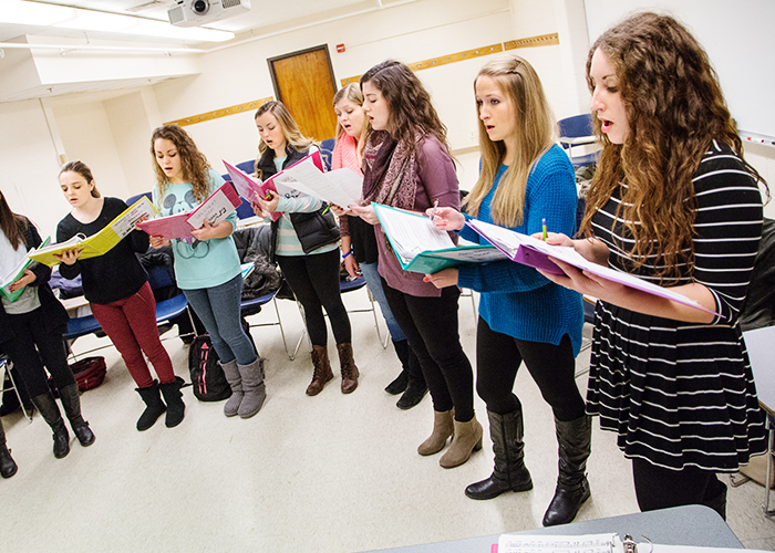 Members of Girls Next Door, the first all-female a cappella group on campus, rehearse the songs in their repertoire.