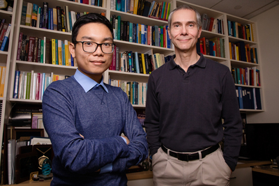 A portrait of University of Illinois, Urbana-Champaign researchers Martin Gruebele, right, and graduate student Huy Nguyen.