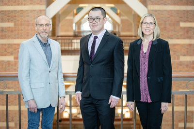 Group photo of Beckman Institute director Jeffrey Moore, left, postdoctoral researcher Hai Qian and materials science and engineering head Nancy Sottos