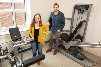 Photo of researchers standing in an exercise laboratory.