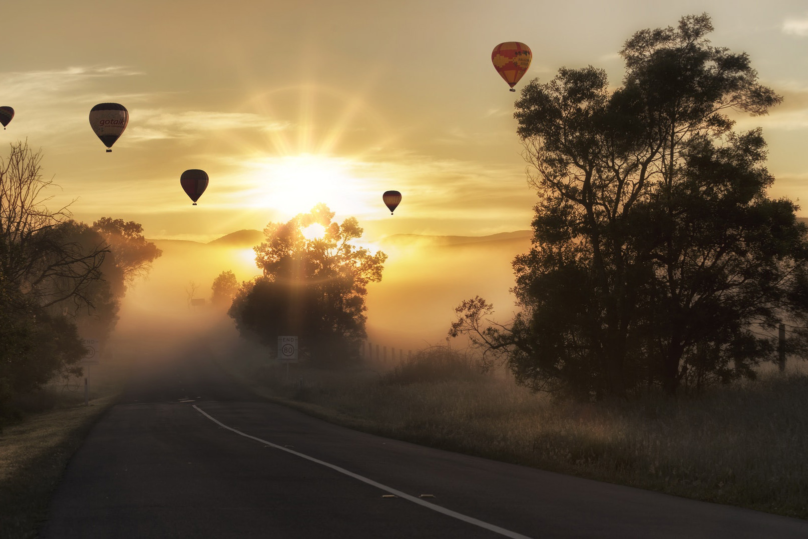 Misty Road and Hot Air Balloons