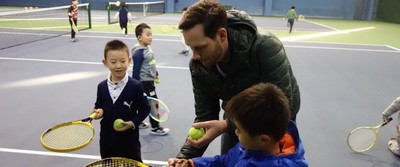 matt haugen helps students with tennis