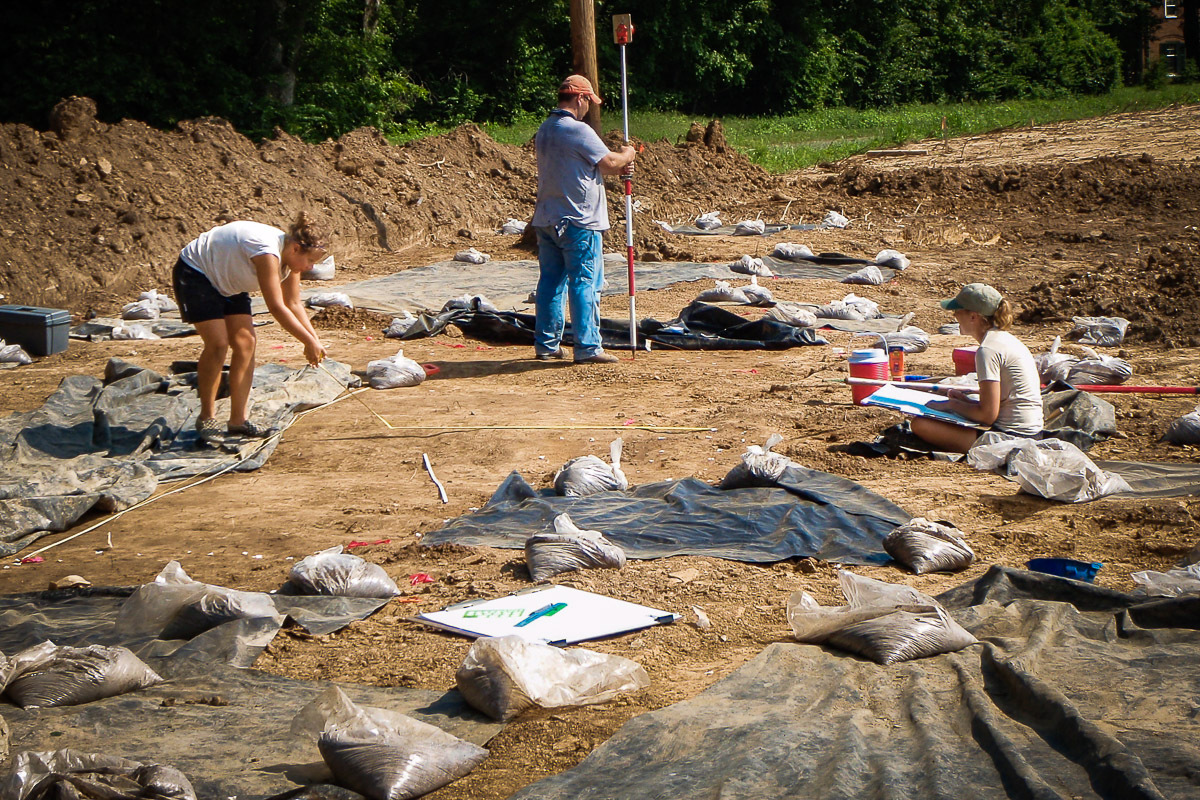 Elizabeth Watts Malouchos (left) and Alleen Betzenhauser (right) map a Mississippian structure at the Pfeffer site in the region outlying Cahokia in 2008.