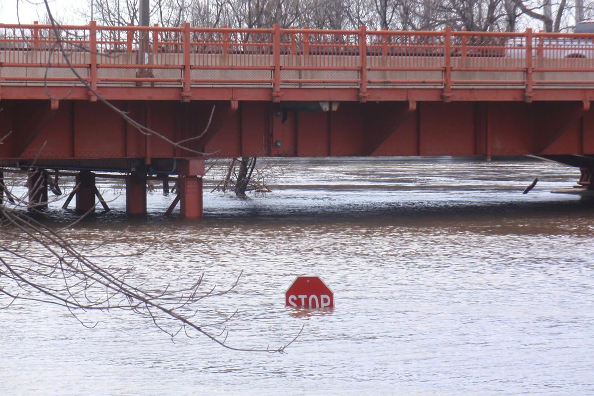 floodwaters covering most of a traffic sign