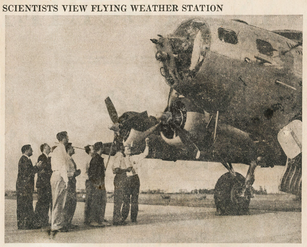 Scientists gather to inspect a B-17 plane which was turned into a weather forecasting station by the U.S. Army.