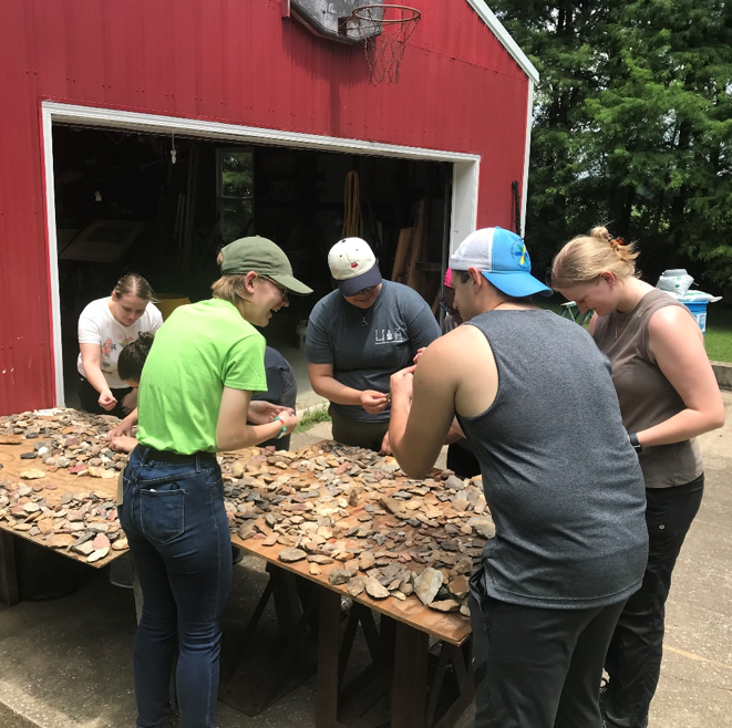 IFR students sorting through archaeological materials being donated to the Center for Archaeological Investigations at SIUC.