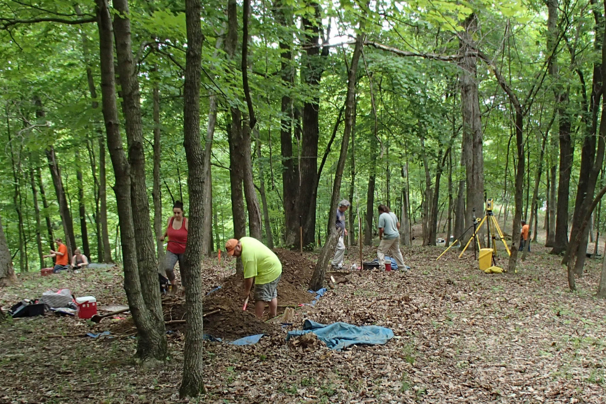 ISAS staff excavating in the woods