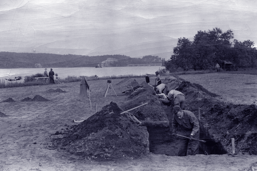 archaeologists digging an excavation