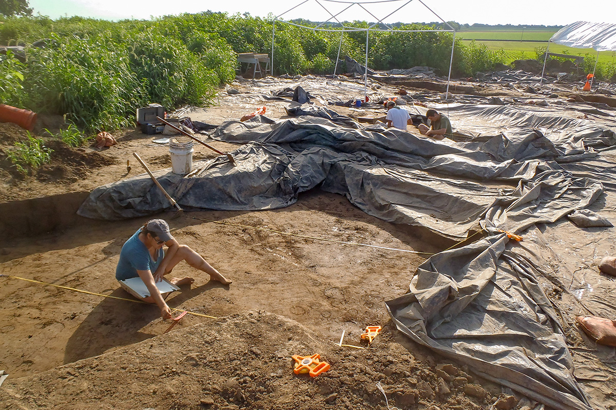 Illinois State Archaeological Survey postdoctoral researcher Rebecca Barzilai maps and collects soil samples from the floor of a religious shrine in Greater Cahokia, an ancient Native American settlement on the Mississippi River in and around present-day St. Louis.