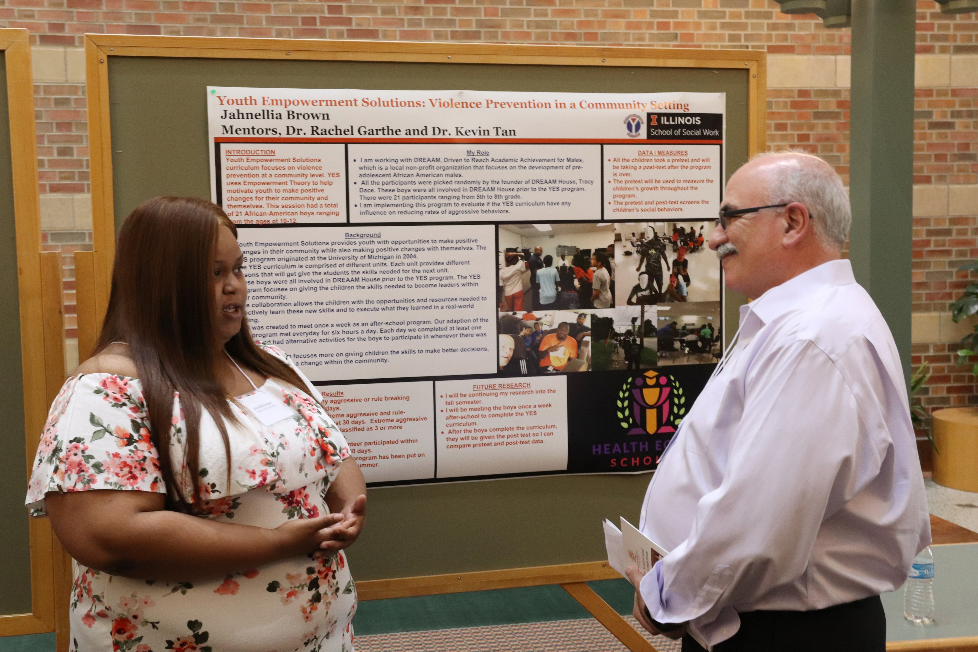 Jahnellia presenting her poster to IHSI director Neal Cohen