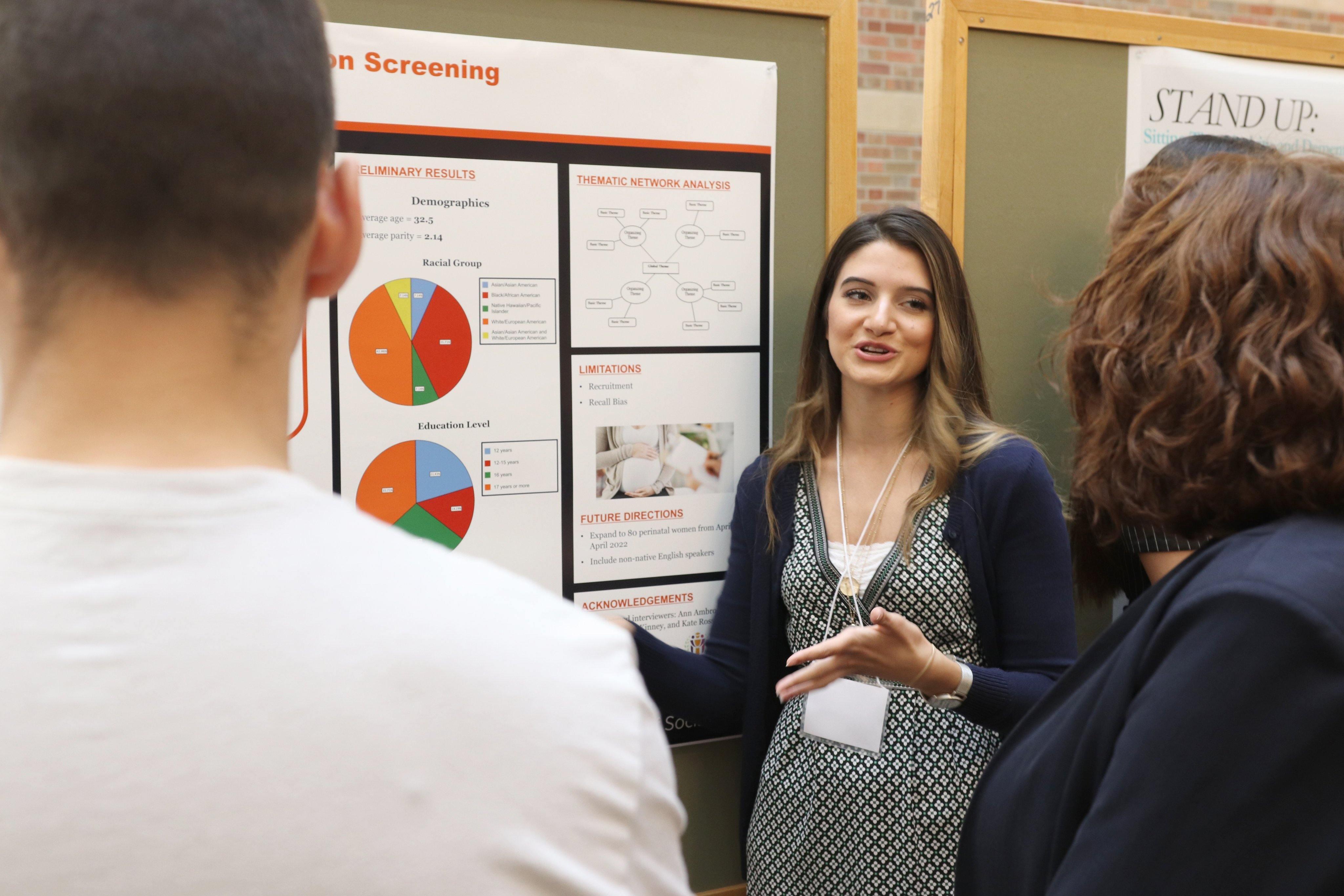 Alex presenting her poster