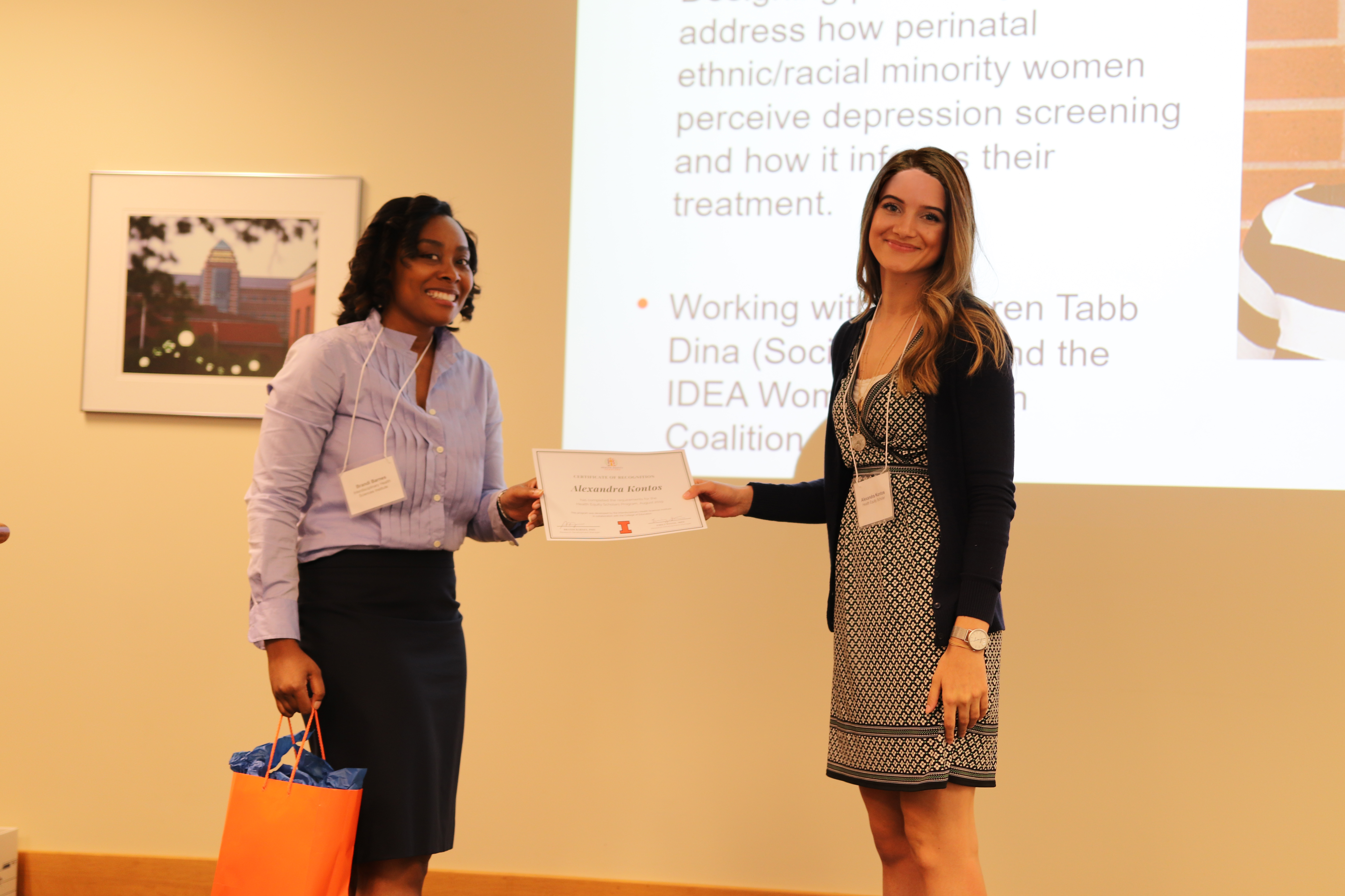 Alex receiving her certificate from Health Equity Scholars program manager Brandi Barnes