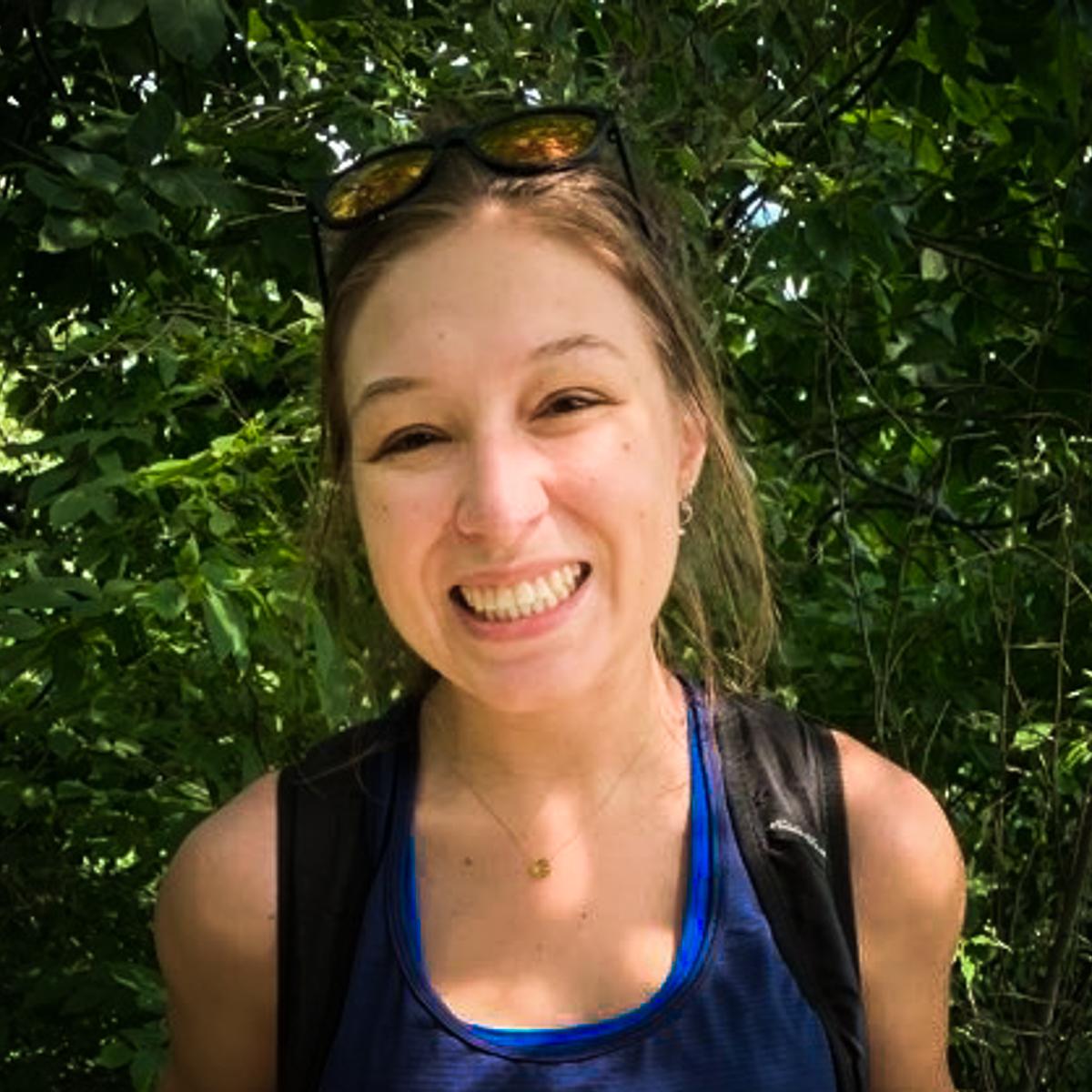 Sara Wilson outdoors near trees.