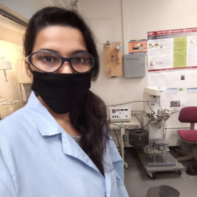 Kirtika Kohli wears a face mask and other PPE in the lab