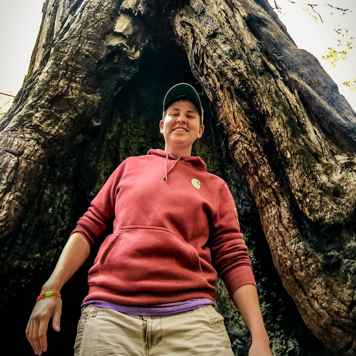 Kristen Ragusa standing next to a tree