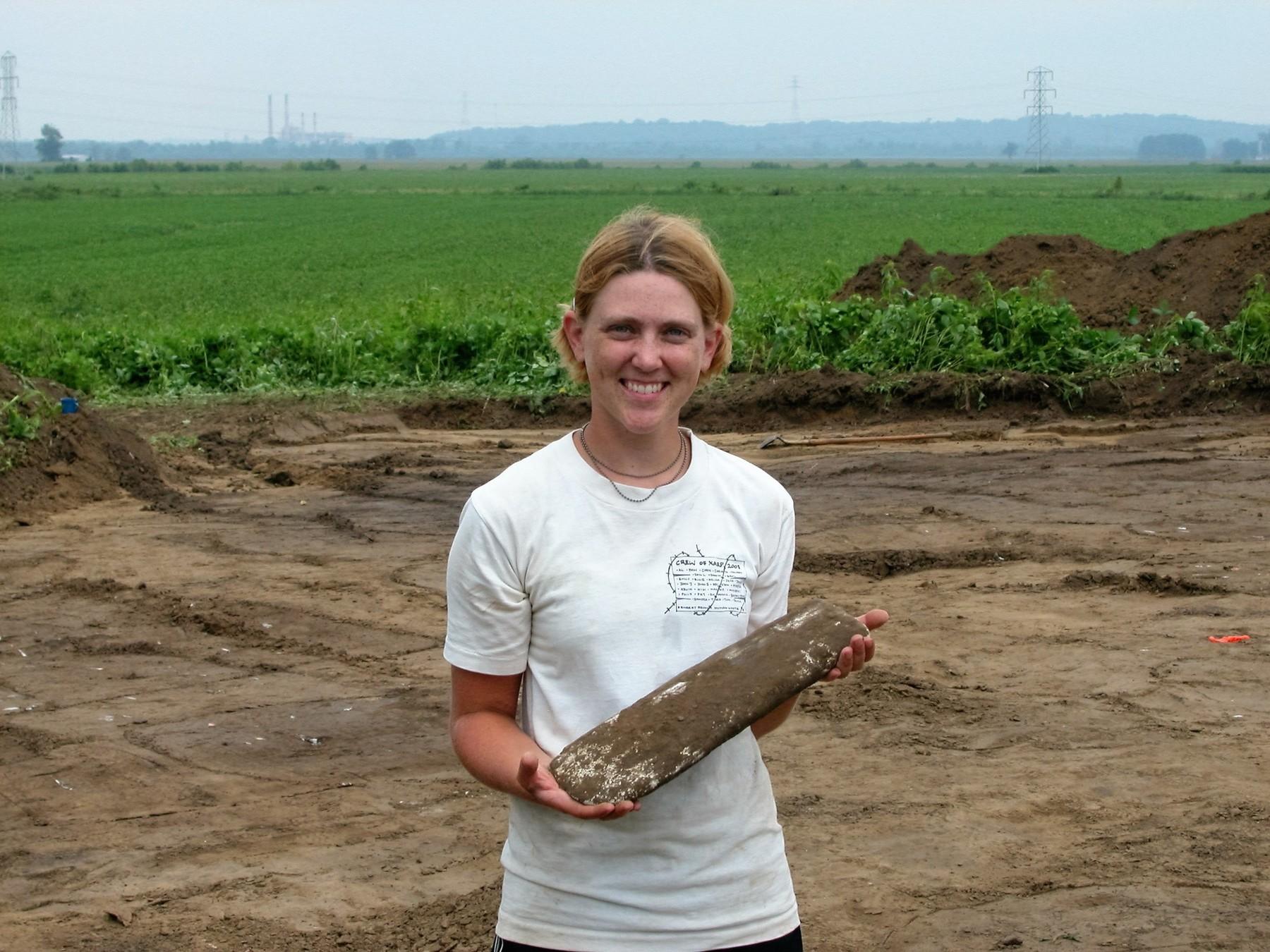 Alleen Betzenhauser holds an artifact