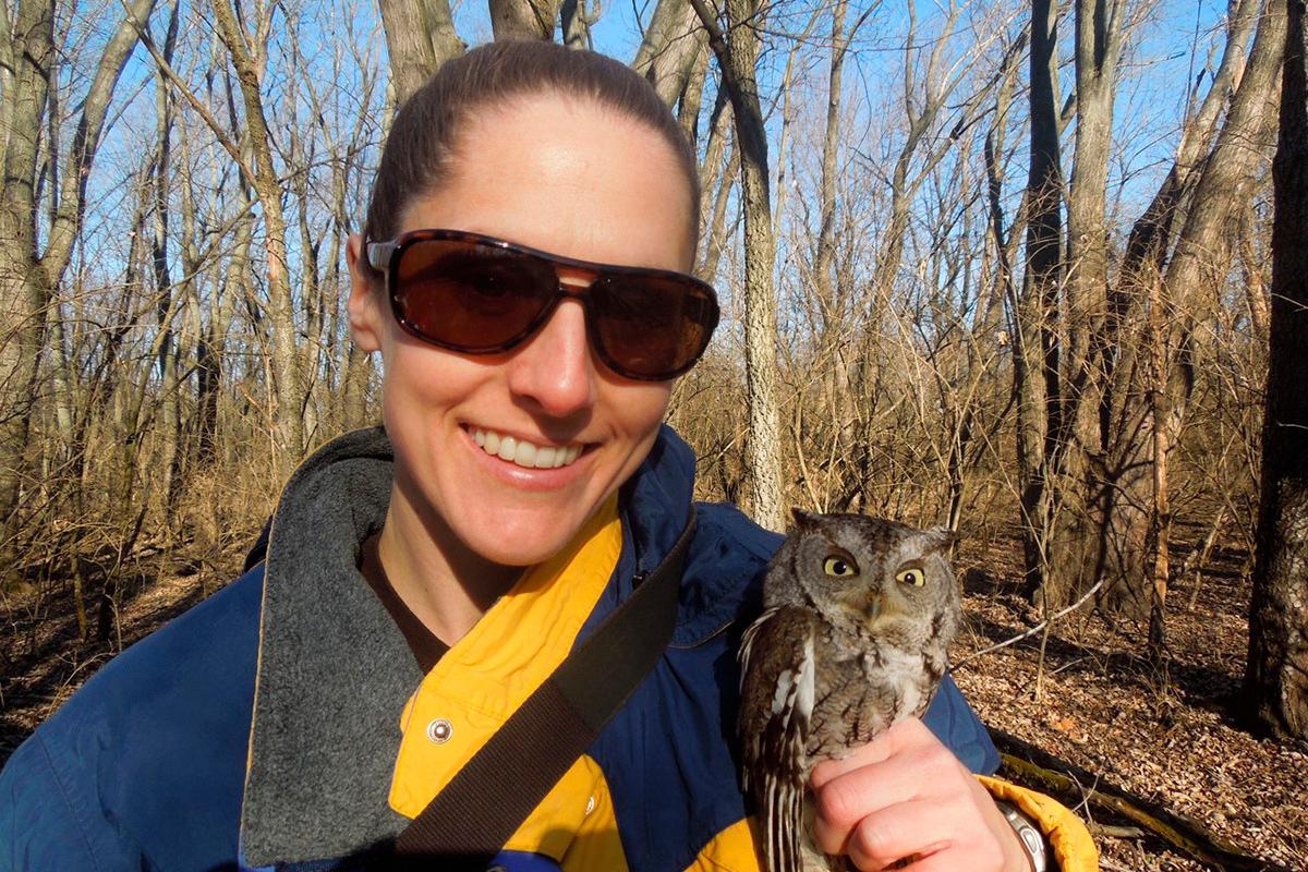 Tara Beveroth holding eastern screech owl