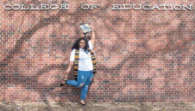 University of Illinois elementary-education graduate Nia Curtis of Chicago