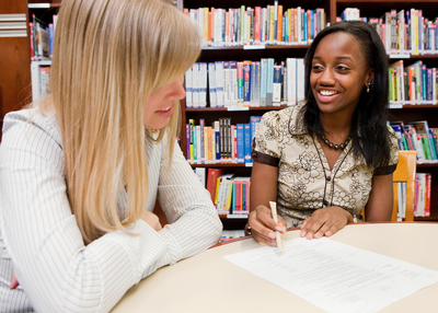 Career Center staff going over resume with student