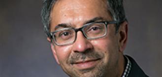 It displays the photo of Illinois ECE  Professor Sanjay Jeram Patel