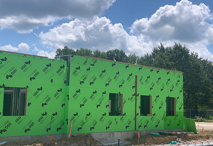 Walls put in place on house under construction