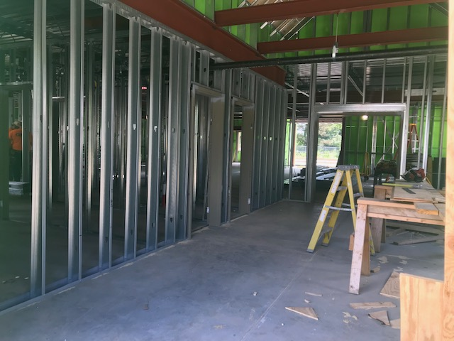 metal studs and steel i-beams of interior of Life Home