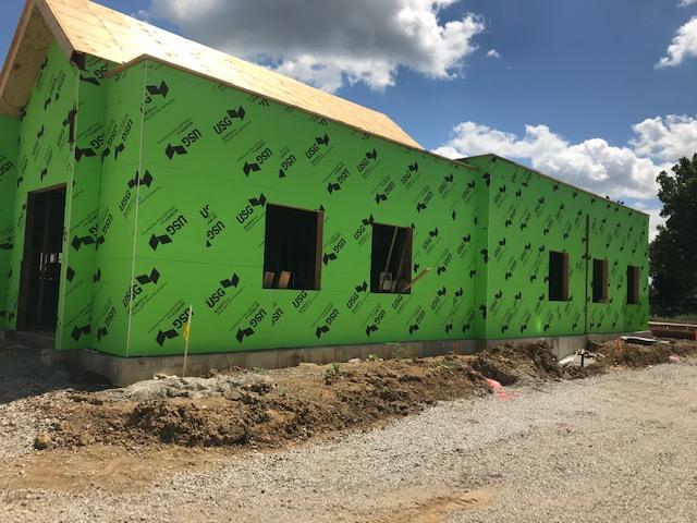 green exterior of walls of building