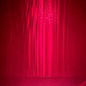 Vertical gradients of pink semiconductor laser light.